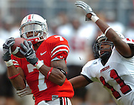 MORNING JOURNAL/DAVID RICHARD.Ted Ginn Jr. of Ohio State pulls in a 57-yard pass from  Troy Smith as Northern Illinois cornerback Alvah Hansbro trails the play yesterday in the fourth quarter.