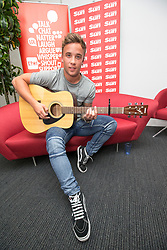Former X Factor star Sam Callahan performing a Facebook Live session.