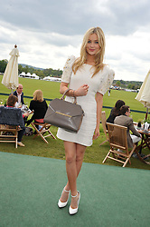 LAURA WHITMORE at the St.Regis International Polo Cup between England and South America held at Cowdray Park, West Sussex on 18th May 2013.  South America won by 11 goals to 9 goals.