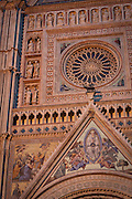 Detail of the rose window adorning the facade of the Duomo di Orvieto, Umbria, Italy.