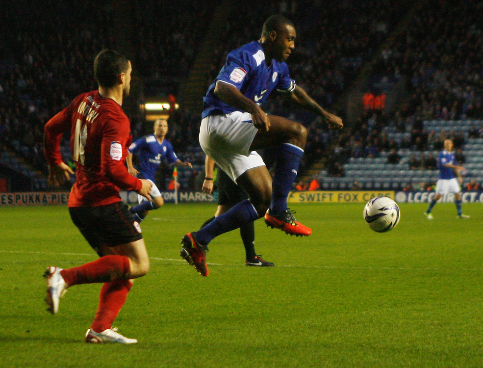 Leicester City's Wes Morgan (R) in action   ..Football - npower Football League Championship - Leicester City v Cardiff City - Saturday 22nd December 2012 - The King Power Stadium - Leicester..© CameraSport - 43 Linden Ave. Countesthorpe. Leicester. England. LE8 5PG - Tel: +44 (0) 116 277 4147 - admin@camerasport.com - www.camerasport.com