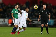 Jordan Ayew  of Swansea city is challenged by Claudio Yacob of West Bromwich Albion. Premier league match, Swansea city v West Bromwich Albion at the Liberty Stadium in Swansea, South Wales on Saturday 9th December 2017.<br /> pic by  Andrew Orchard, Andrew Orchard sports photography.