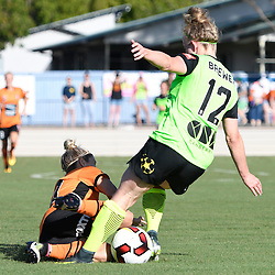BRISBANE, AUSTRALIA - OCTOBER 30: Hannah Brewer of Canberra United is tackled by Katrina Gorry of the Roar during the round 3 Westfield W-League match between the Brisbane Roar and Canberra United at AJ Kelly Field on November 20, 2016 in Brisbane, Australia. (Photo by Patrick Kearney/Brisbane Roar)