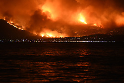 August 14, 2017 - Eretria, Attica, Greece - Massive wildfire with multiple front burning houses at Kalamos Attika, scene shot from a distance of 5 km in Amarynthos, Eretria on Euboea on August 14, 2017  (Credit Image: © Wassilios Aswestopoulos/NurPhoto via ZUMA Press)