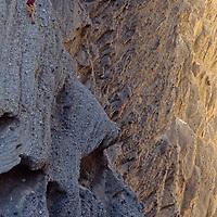 Mountaineer Mark Newcomb rappels below massive Shipton's Arch in the Kara Tagh Mountains near Kashgar, Xinjiang, China.