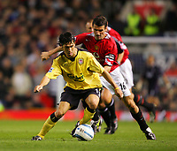 MANCHESTER, ENGLAND - MONDAY SEPTEMBER 20th 2004: Liverpool's Luis Garcia Manchester United's Roy Keane during the Premiership match at Old Trafford. (Photo by David Rawcliffe/Propaganda)