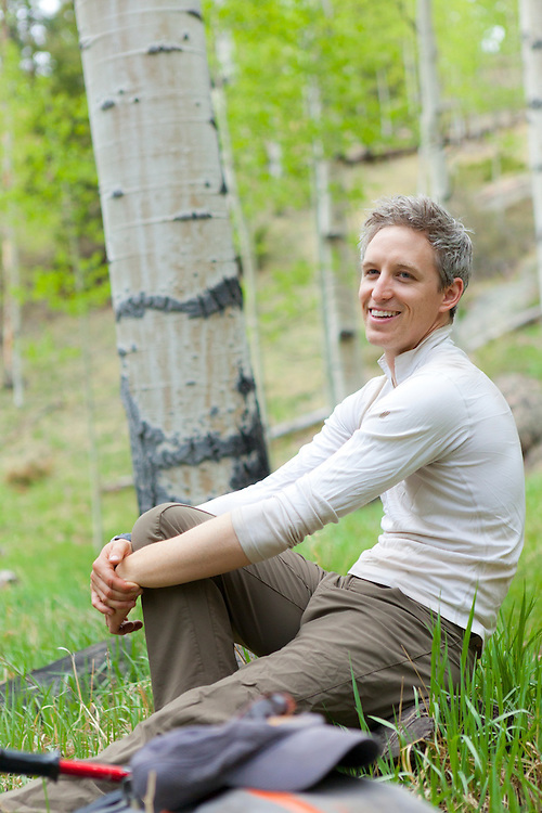 David Coffey relaxes in an aspen grove along the Goose Creek Trail, Lost Creek Wilderness, Colorado.