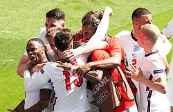 England's Raheem Sterling (left) celebrates scoring their side's first goal of the game with team-mates during the UEFA Euro 2020 Group D match at Wembley Stadium, London. Picture date: Sunday June 13, 2021.