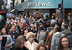 © Licensed to London News Pictures. 19/12/2015. London, UK. Shoppers throng past John Lewis in Oxford Street on the last Saturday before Christmas. Photo credit: Peter Macdiarmid/LNP