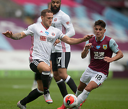 Ashley Westwood of Burnley (R) and Billy Sharp of Sheffield United in action - Mandatory by-line: Jack Phillips/JMP - 05/07/2020 - FOOTBALL - Turf Moor - Burnley, England - Burnley v Sheffield United - English Premier League