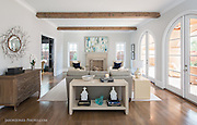 Contemporary Modern luxury family living room with exposed beams and hardwood floors. High end furniture and interior design accentuate the architecture in this bright white modern room.