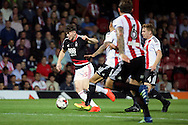 Nottingham Forest midfielder Oliver Burke (35) surrounded by Brentford players during the EFL Sky Bet Championship match between Brentford and Nottingham Forest at Griffin Park, London, England on 16 August 2016. Photo by Matthew Redman.