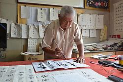 SHIJIAZHUANG, Sept. 7, 2016 (Xinhua) -- Zhang Xing'en writes calligraphy at home in Xiguan Town, Gaocheng District of Shijiazhuang, capital of north China's Hebei Province, Sept. 6, 2016. 81-year-old Zhang Xing'en has been teaching students of Xiguan Elementary School in Gaocheng District calligraphy voluntarily for more than three years to intensify their aesthetic sensibility for calligraphy. (Zhang Jiangang)(wsw) (Credit Image: © Zhang Jiangang/Xinhua via ZUMA Wire)