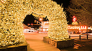 Elk antler arch at night in the town square, Jackson, Wyoming USA