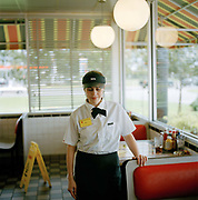 "Daisy, waitressing at a waffle house on 10 Highway, Baton Rouge. One of the joys of a road trip is sampling the many original 'dinner' restaurants built in the fifties and still with all the original fittings and  fixtures ""happy days"" style."