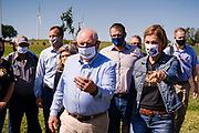 03 SEPTEMBER 2020 - RADCLIFFE, IOWA: SONNY PERDUE, the US Secretary of Agriculture walks through field on a farm in central Iowa. Perdue made a secretarial disaster declaration for 42 counties in central Iowa during a farm visit in central Iowa Thursday. Perdue was accompanied by Governor Kim Reynolds and US Senator Joni Ernst. The secretarial disaster declaration frees up more federal funds, from the Department of Agriculture, to help in recovery from the derecho storm that wiped out about one-third of Iowa's corn crop on Monday, August 10, 2020. Many Iowa farmers are still rebuilding lost buildings or plowing under lost crops.         PHOTO BY JACK KURTZ
