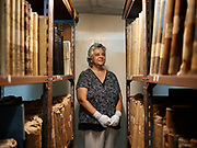 """Karen henry, working at custodian of the records ( archive ) for the past 10years<br /> where they keep all the important documents from St. Helena History.<br /> <br /> All of its attributes – tropical, volcanic, mountainous and moonlike – can be found in equal measure. This may explain why Charles Darwin waxed lyrical about St. Helena in his memoir """"The Voyage Of The Beagle"""", and why astronomer Edmond Halley set up a marquee observatory on Diana's Peak. With zero light pollution, the skies are a feast of huge, twinkling stars.<br /> <br /> The Napoleon connection is anyway the main reason for visiting. After his defeat at the Battle of Waterloo in June 1815, the French Emperor Napoleon Bonaparte was exiled to St. Helena and arrived in October 1815. He died and was buried there in May 1821. In 1840, his body was exhumed and returned to France.<br /> <br /> The 200th anniversary of Napoleon's death (May 2021) should bring a much-needed increase in tourists. Tourism is also supposed to boost efforts towards the island becoming more self-sufficient and less isolated. If this can drag the island out of an economic slump, then so much the better."""