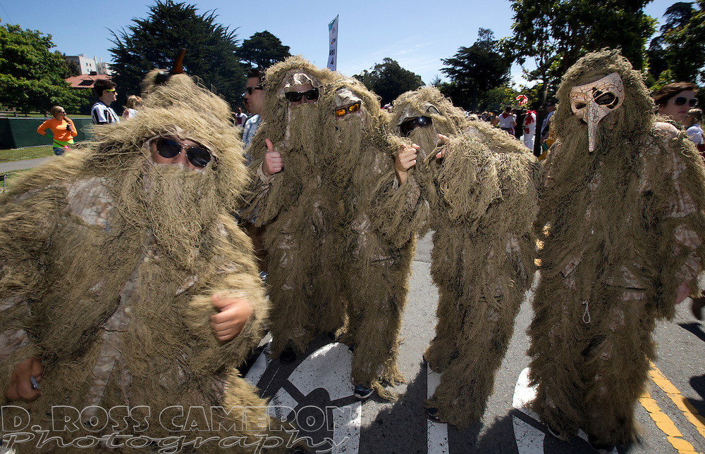 Clad in their ghillie suits, a group of men from the East Bay stealthily pass through Golden Gate Park during the 103rd running of the Bay to Breakers 12K race, Sunday, May 18, 2014 in San Francisco. (Photo by D. Ross Cameron)