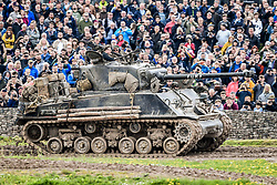 """An M4A2(76) HVSS Sherman tank, drives around the tank course at the Tank Museum in Bovington, Dorset, as the attraction hosts """"Tiger Day"""" to mark the 75th anniversary of the world's only working Tiger Tank's capture in 1943 in the Tunisian desert."""