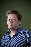 English playwright and novelist Edward Carey, pictured at the Edinburgh International Book Festival where he talked about his latest work. The three-week event is the world's biggest literary festival and is held during the annual Edinburgh Festival. The 2014 event featured talks and presentations by more than 500 authors from around the world and was the 31st edition of the festival.
