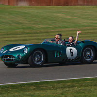 The Duke of Richmond takes Lady Susie Moss on a demonstration run in the 1959 Aston Martin DBR1 to celebrate Sir Stirling Moss 90th birthday at Goodwood Revival 2019