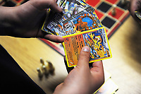 Nathaniel Ashlin, 11, shows off his Pokemon cards at the warming shelter in Salinas. He is there with his mom Joan Sassman.