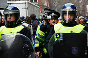 Riot police video evidence officer. Anti capitalists / anarchists go on the rampage through central London on the back of the peaceful TUC protest march. The masked demonstrators ran a twisting route through the capital confusing the police and creating a situation which was very difficult to manage. The protesters attacked banks, shops and hotels, and the police in riot gear fought  face to face with them as they were pelted with ammonia, paint and fireworks loaded with coins.