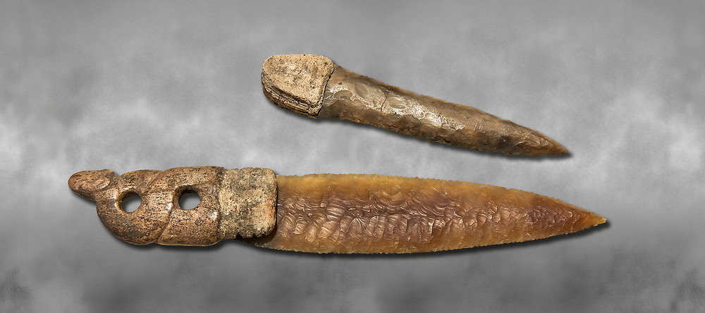 Brown obsidian dagger with a bone handle carved into the shape of a snake. It is believed this may have been a ritual dagger. Catalhoyuk Collections. Museum of Anatolian Civilisations, Ankara. Against a gray mottled background .<br /> <br /> If you prefer you can also buy from our ALAMY PHOTO LIBRARY  Collection visit : https://www.alamy.com/portfolio/paul-williams-funkystock/prehistoric-neolithic-art.html - Type Catalhoyuk into the LOWER SEARCH WITHIN GALLERY box. Refine search by adding background colour, place, museum etc.<br /> <br /> Visit our PREHISTORIC PLACES PHOTO COLLECTIONS for more  photos to download or buy as prints https://funkystock.photoshelter.com/gallery-collection/Prehistoric-Neolithic-Sites-Art-Artefacts-Pictures-Photos/C0000tfxw63zrUT4