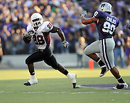 MANHATTAN, KS - SEPTEMBER 05:  Running back Tony Nelson #28 of the Massachusetts Minutemen rushes to the outside againt pressure from defensive end Eric Childs #90 of the Kansas State Wildcats during the first quarter on September 5, 2009 at Bill Snyder Family Stadium in Manhattan, Kansas.  (Photo by Peter G. Aiken/Getty Images)