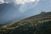 Light rays illuminating rice terraces outside Sapa, Northern Vietnam