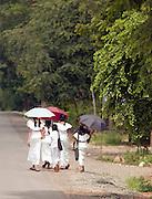 Girls with sun umbrellas in southern Sri Lanka