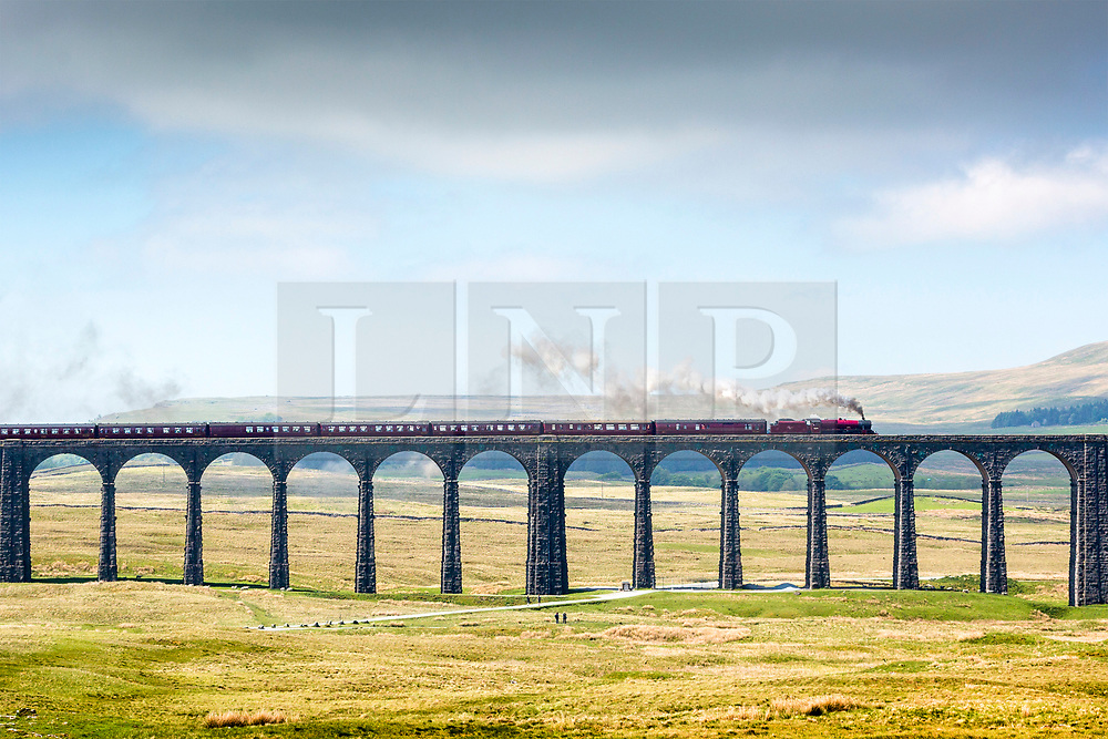 © Licensed to London News Pictures. 29/05/2018. Ribblehead UK. The 1936 Locomotive 45699 Galatea pulling the Fellsman across the 24 arches of the famous Ribblehead viaduct in the Yorkshire Dales today. Photo credit: Andrew McCaren/LNP