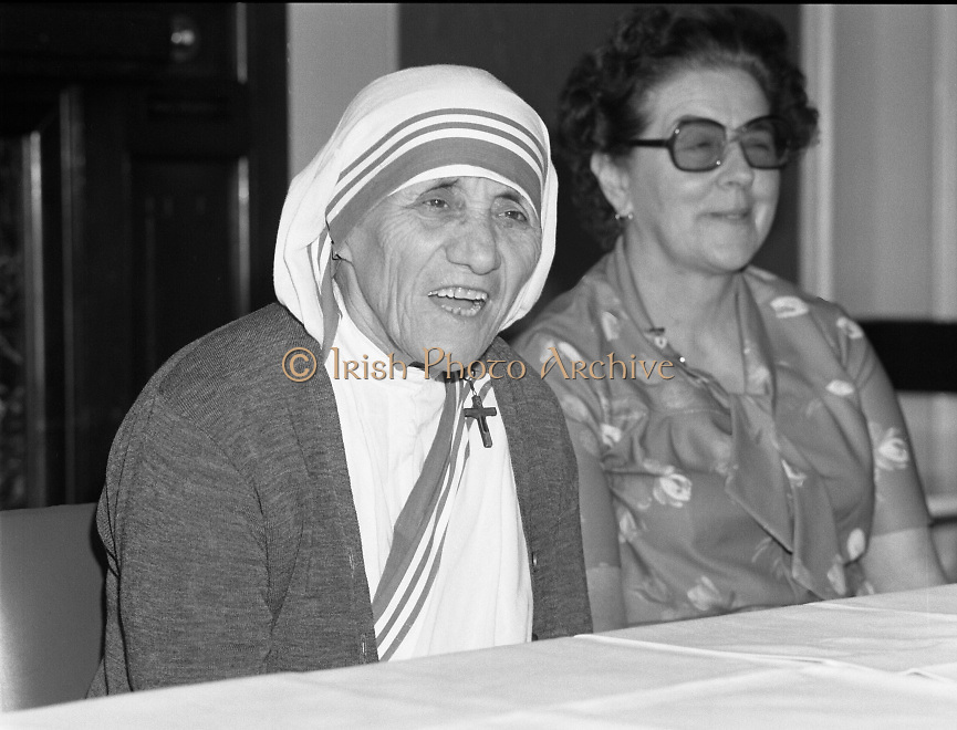 Mother Teresa of Calcutta speaks at press conference  organised by SPUC (Society for the Protection of Unborn Children)..1982-08-02.2nd August 1982.2/08/1982.08-02-82..Pictured at Wynns Hotel, Dublin..From Left:..Mother Teresa.Menia Aitken, Development Officer for SPUC, Ireland.<br /> <br /> Images of  Mother Teresa of Calcutta, in Dublin, Ireland.<br /> Famous  Views of  Mother Teresa of Calcutta, in Dublin, Ireland.<br /> black and white photos of  Mother Teresa of Calcutta, in Dublin, Ireland.<br />  pictures of  Mother Teresa of Calcutta, in Dublin, Ireland.<br />  Old pictures  of  Mother Teresa of Calcutta, in Dublin, Ireland.<br />  Mother Teresa of Calcutta, in Dublin, Ireland.<br />  Irish historic photo of Mother Teresa of Calcutta, in Dublin, Ireland.<br /> Historic images of Mother Teresa of Calcutta, in Dublin, Ireland.<br />  Irish historic images  of Mother Teresa of Calcutta, in Dublin, Ireland.