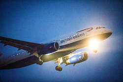 British Airways aircraft on approach to Edinburgh airport in the late November 2014 afternoon winter twilight.