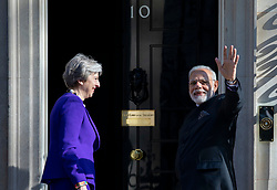 © Licensed to London News Pictures. 18/04/2018. London, UK. Indian Prime Minister Narendra Modi (R) waves as he meets Prime Minister Theresa May at 10 Downing Street. Photo credit: Rob Pinney/LNP