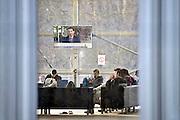 Nederland, the Netherlands, Nijmegen, 15-12-2015 Kamp, tentenkamp Heumensoord, de tijdelijke noodopvang, azc, van het COA. Plaats voor 3000 asielzoekers. Mensen wandelen buiten. Door de zachte winter is het in de tenten nog niet zo koud. Bij de televisie in de recreatieruimte van de grote tent. FOTO: FLIP FRANSSEN