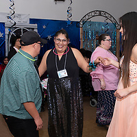 """Left to right, Jeremiah Tom, Kayla Thomas and Ariel Begay dance together Friday night at """"Night to Shine,"""" at New Life Christian Assembly Church in Pinedale. """"Night to Shine"""" is a prom for local teens and adults with special needs sponsored by the Tim Tebow Foundation."""