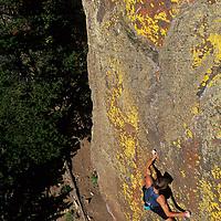 ROCK CLIMBING. Alex Lowe (MR) solo climbs Practice Wall (5.11)