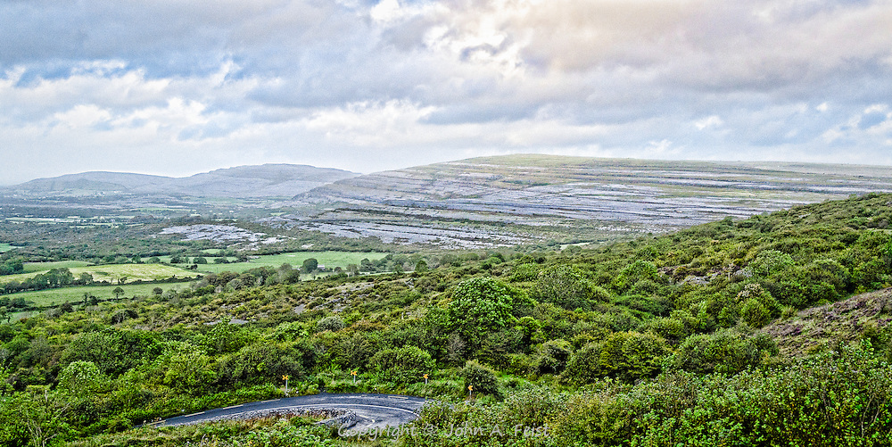 The Burren in County Clare, Ireland is an incredible place.  Everywhere there are rocks and outcroppings.  It is a marvel of nature.  You can see a typical (aka narrow and very windy) road in the foreground and the rocky landscape rising in the distance.  We were there on an overcast and rainy day so the sky was kind enough to add some drama.