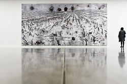 """© Licensed to London News Pictures. 14/11/2019. LONDON, UK. A visitor views """"Die Sieben Siegel, die geheime Offenbarung des Johannes"""", 2016-2018, by Anselm Kiefer at the preview of a new exhibition called """"Superstrings, Runes, The Norns, Gordian Knot"""" by Anselm Kiefer.  The works include large scale paintings and installations that draw on the scientific concept of string theory and are on display at the White Cube Gallery in Bermondsey 15 November to 26 January 2020.  Photo credit: Stephen Chung/LNP"""