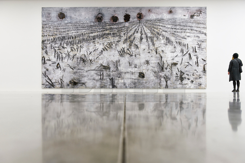 "© Licensed to London News Pictures. 14/11/2019. LONDON, UK. A visitor views ""Die Sieben Siegel, die geheime Offenbarung des Johannes"", 2016-2018, by Anselm Kiefer at the preview of a new exhibition called ""Superstrings, Runes, The Norns, Gordian Knot"" by Anselm Kiefer.  The works include large scale paintings and installations that draw on the scientific concept of string theory and are on display at the White Cube Gallery in Bermondsey 15 November to 26 January 2020.  Photo credit: Stephen Chung/LNP"