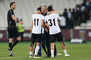 Marius Sumudica , manager of Astra Giurgiu kisses Constantin Florea of Astra Giurgiu and Alexandru Ionița of Astra Giurgiu after full time. UEFA Europa league, 1st play off round match, 2nd leg, West Ham Utd v Astra Giurgiu at the London Stadium, Queen Elizabeth Olympic Park in London on Thursday 25th August 2016.<br /> pic by John Patrick Fletcher, Andrew Orchard sports photography.