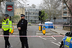© Licensed to London News Pictures. 02/04/2019. London, UK. A police tent and police officers at the crime scene on Grafton Road, junction with Vicars Road in Kentish Town, north west London where a man in his 20s was found stabbed around 8.30pm on Monday 1 April 2019. He was pronounced dead at the scene. Photo credit: Dinendra Haria/LNP