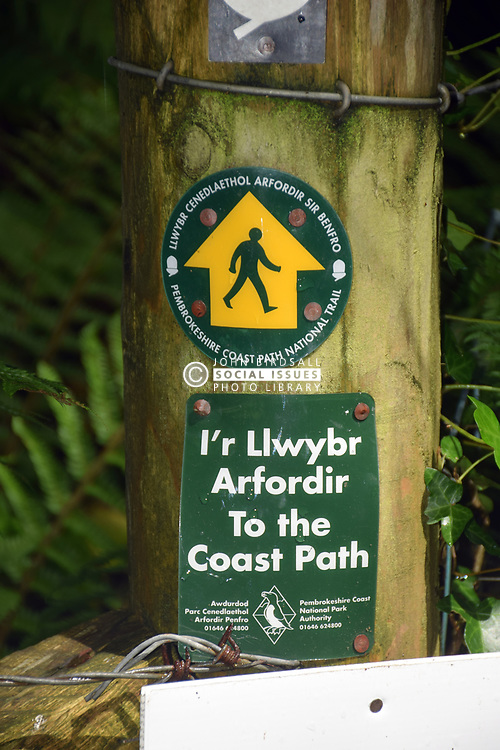 Pembrokeshire Coast Path sign in both English and Welsh, South Wales 2021