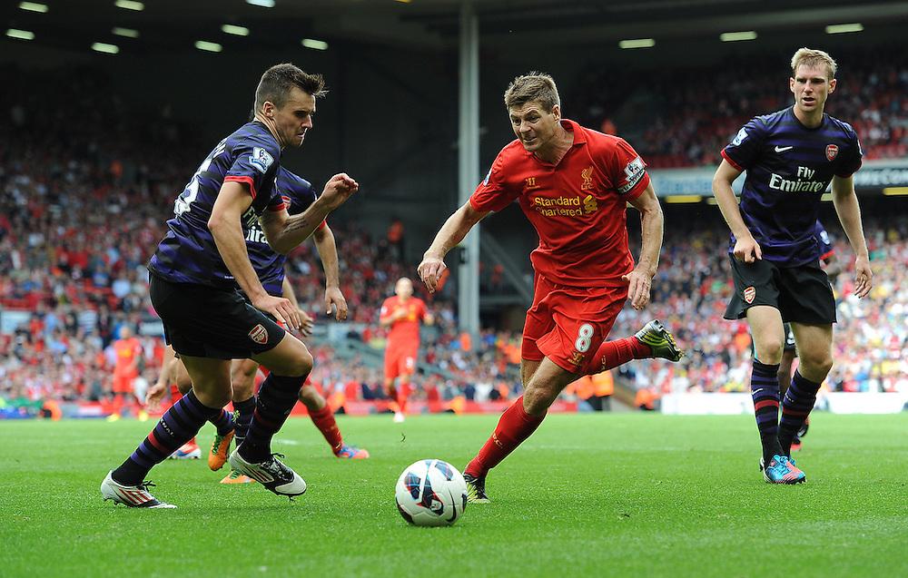 Liverpool's Steven Gerrard takes on Arsenal's Carl Jenkinson ..Football - Barclays Premiership - Liverpool v Arsenal - Sunday 2nd September 2012 - Anfield - Liverpool..