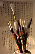 Still life of brushes and calligraphy in a Beijing studio, China.
