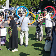 TOKYO, JAPAN August 6:   Members of the public, unable to attend the Olympic Games due to covid restriction, take photographs with the Olympic Rings outside the Olympic Stadium  at the Tokyo 2020 Summer Olympic Games on August 6th, 2021 in Tokyo, Japan. (Photo by Tim Clayton/Corbis via Getty Images)