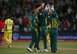 Kyle Abbott of South Africa is congratulated by South African captain Faf du Plessis and Quinton de Kock of South Africa for getting Matthew Wade of Australia wicket during the 5th ODI match between South Africa and Australia held at Newlands Stadium in Cape Town, South Africa on the 12th October  2016<br /> <br /> Photo by: Shaun Roy/ RealTime Images