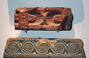 Architectural features from the 'Treasury of Atreus' (circa 1350-1259 BC). Taken from the Tomb of Agamemnon in Mycenae, Greece. Green Limestone and Red Marble.