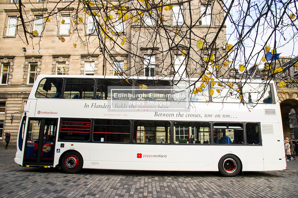 Pictured: <br /> <br /> Lothian Buses launches its 'Poppy Bus'. The vehicle, which is white with quotes from well-known war poems painted on it, will run on various routes throughout November. Ex-Forces staff and Poppy Scotland head of fundraising Gordon Michie were there to give it a good send off<br /> <br /> Ger Harley   EEm 27 October 2016